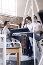 Physical therapists helping man on treadmill - CAIF11678