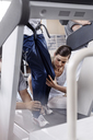 Physical therapists guiding man on treadmill - CAIF11681