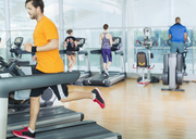 Man running on treadmill at gym - CAIF11756