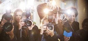 Portrait of paparazzi in a row with cameras and microphone - CAIF12002
