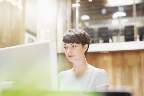 Businesswoman working at computer in office - CAIF12059