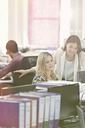 Fashion designers working at desk in office - CAIF12083