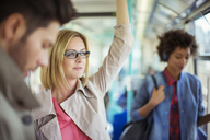 Businesswoman riding train - CAIF12107