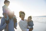 Happy family having fun on beach - CAIF12149