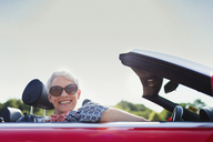 Portrait senior woman driving convertible - CAIF12224