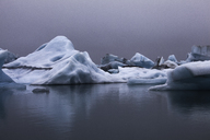 Blue icebergs in calm water, Jokulsarlon, Iceland - CAIF12239