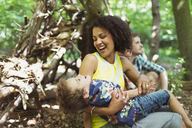 Playful mother and son in woods - CAIF12314