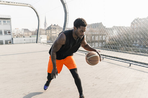 Basketball player in action on court - UUF13025