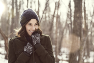 Happy woman looking away in forest - CAVF05727