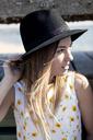 Woman wearing sun hat looking away - CAVF06018