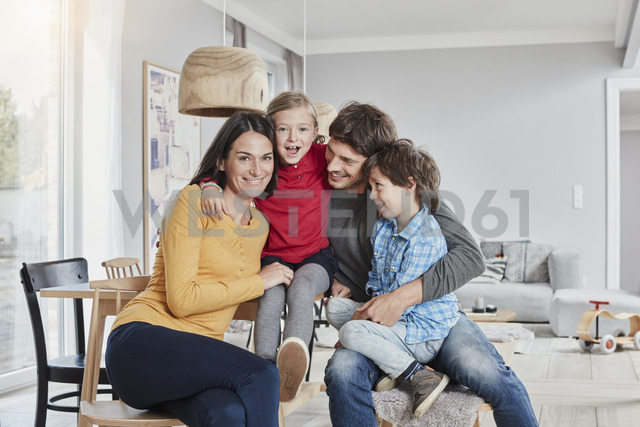 Portrait of happy family with two kids at home - RORF01184