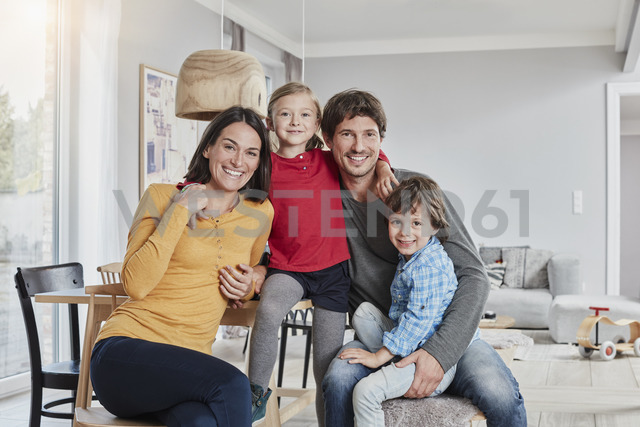 Portrait of happy family with two kids at home - RORF01187