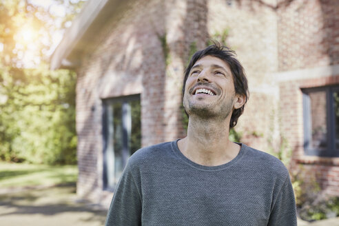 Portrait of happy man in front of his home - RORF01190