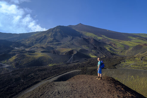 Italy, Sicily, Mount Etna, hiker looking at view - LBF01848