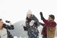Couple enjoying snowball fight - CAIF12359