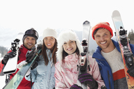 Portrait of happy friends with skis - CAIF12386