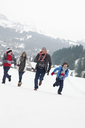 Happy family running in snowy field - CAIF12389