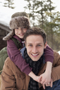 Close up portrait of happy father piggybacking son - CAIF12404