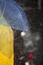 Close up of woman under umbrella in rain - CAIF12452