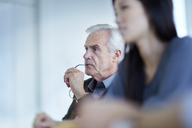 Focused senior businessman listening in meeting - CAIF12629
