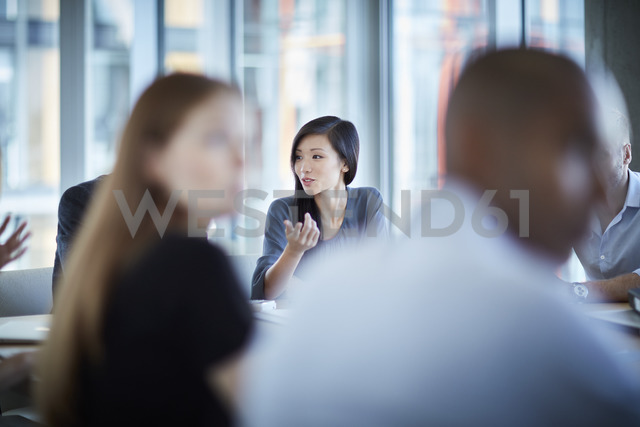Businesswoman gesturing in meeting - CAIF12632