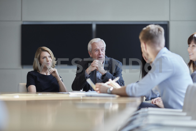 Business people talking in meeting - CAIF12638