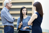 Business people talking in lobby - CAIF12644