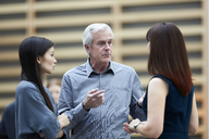 Business people talking in lobby - CAIF12656