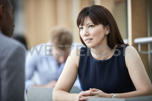 Businesswoman listening to businessman - CAIF12659