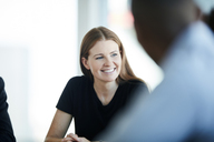 Smiling businesswoman in meeting - CAIF12665