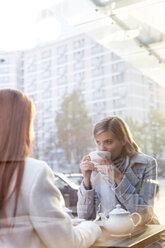 Women drinking tea at sidewalk cafe - CAIF12797