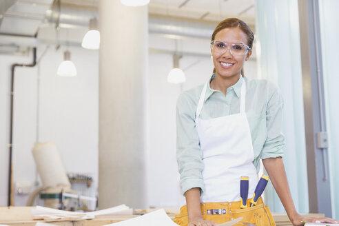 Portrait smiling carpenter in workshop - CAIF12863