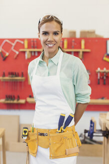 Portrait confident female carpenter in workshop - CAIF12872