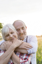 Close up portrait serene senior couple hugging with eyes closed - CAIF13061