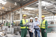 Portrait confident engineers and workers in steel factory - CAIF13199