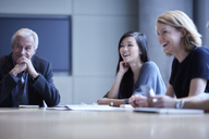 Businesswomen laughing in meeting - CAIF13271