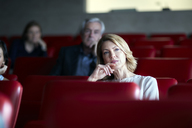 Attentive businesswoman listening in seminar audience - CAIF13286