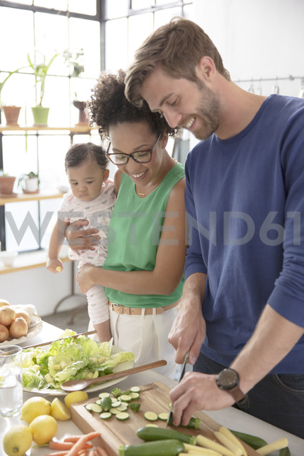 Happy family preparing meal in domestic kitchen - CAIF13298 - Sam Edwards/Westend61