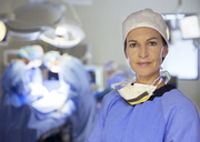 Portrait of confident surgeon in operating room - CAIF13349