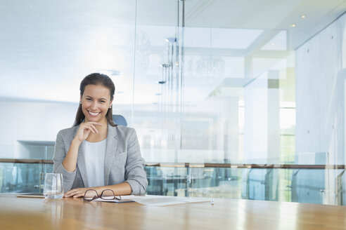 Portrait confident businesswoman at conference room table - CAIF13397