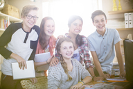 Group portrait of smiling teenagers at home - CAIF13415