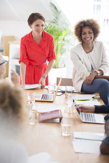 Women talking during business meeting - CAIF13802