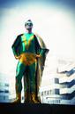Superhero standing near city skyline - CAIF13952