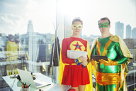 Superheroes standing in office - CAIF13955