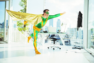 Superhero flying in office - CAIF13958