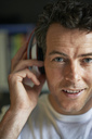 Smiling man with headphones on, close up - CAIF13985