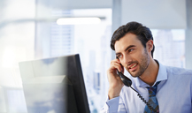 Man using landline phone in office - CAIF13988