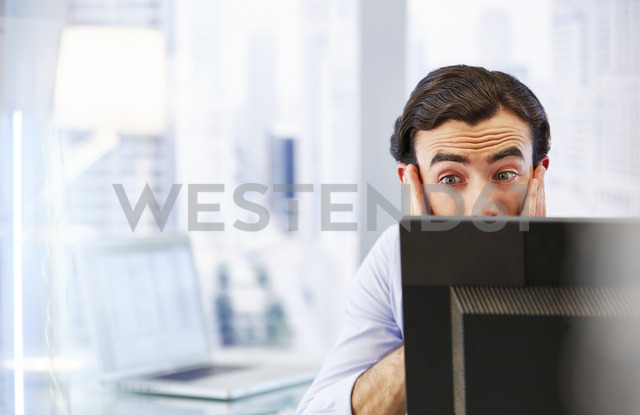 Man using computer in office,stressed and worried - CAIF14024