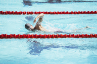 Swimmer racing in pool - CAIF14150