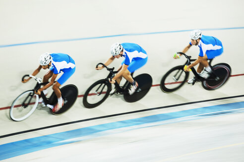 Track cycling team racing in velodrome - CAIF14153